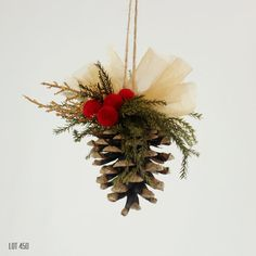 Pine cone Christmas tree ornament, with gold sheer ribbon, gold leaves and dried red button flowers. With preserved pine and a twine hanging loop. Approximately 3 x 2 Traditional Christmas style Preserved evergreens Dried flowers Long lasting Pine Cone Christmas Decorations, Red And Gold Christmas Tree, Pine Cone Christmas Tree, Pinecone Ornaments, Christmas Bows, Christmas Centerpieces, Holiday Wreaths, Rustic Christmas, Christmas Tree Ornaments