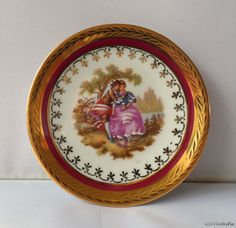 Limoges France porcelain wall plates inc brass holders with Fragonard's love themes. Ruby red and 24k gold by SoVintastic, €8.50 resp. € 10,00 only!