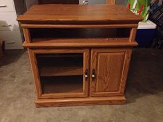 DIY Play Kitchen: Repurposing an old entertainment Center      While trolling Pinterest, I decided to try my hand at re-purposing an entert...