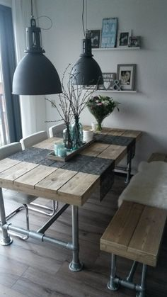 Love this dining space. Rustic, eclectic, industrial.