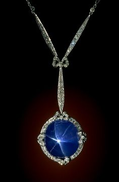 Corundum (variety: Star Sapphire)    This art deco-style necklace features a 60-carat sky blue star sapphire in a platinum setting accented with 126 diamonds. The necklace was designed by Marcus & Company.    Image Number: 96-30144  Catalog Number: G8887  Weight: 60 carats  Mrs. C. W. Crane , 1981