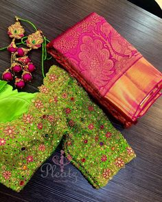 Can not stop admiring this jewel blouse! Love all the colours! Stunning pink color pattu saree and parrot green color designer blouse with floral design hand embroidery saree work.  27 September 2018
