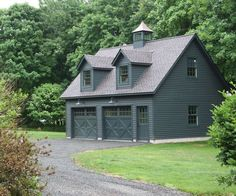 x Elite Cape Garage with Painted Cedar Clapboard siding 2 Gabled dormers Custom Carriage style overhead doors with glass Extra windows Window upgrades Cupola and Custom finishing by homeowner. - April 20 2019 at