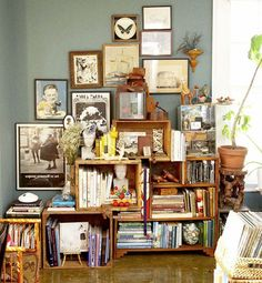 I just love the collage effect of the crates of books against the pictures on the wall.