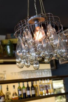 Feminine industrial ... chandeliers I made from vintage turkey feeder cages & handblown glass drops ... for Cucina Urbana & Cucina Enoteca restaurants