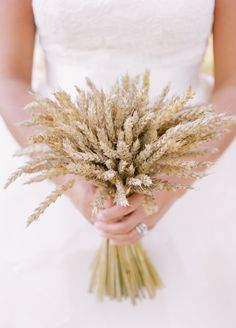 A bouquet made entirely of wheat- perfect for a Fall wedding! // photo by KMI Photography
