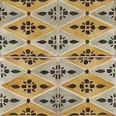 La Terre Deco Ceramic Tiles. Square tiles with yellow and gray diamonds and a black flower. Gorgeous as a kitchen backsplash.