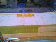 1.)  First job of the new week...re-levelling the kitchen windowsill as the previous method was an epic fail!  Armed with ply...