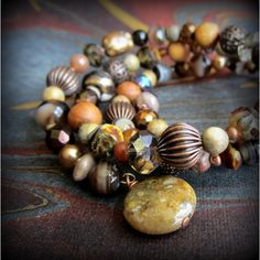 Handcrafted BOHO beaded wrap bracelet rich earthy brown gemstone,... ($32) ❤ liked on Polyvore featuring jewelry, bracelets, copper bangles, glass bead jewelry, handcrafted jewelry, wrap bracelet and beaded wrap bracelet