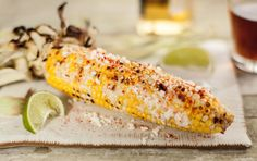 In a nod to the corn-on-the-cob often served by street vendors in Mexico, sweet corn is brushed with a smoky chipotle spread before grilling, and then finished with crumbled cheese, cayenne and a squeeze of fresh lime juice.