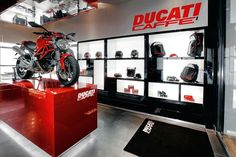 Ducati Caffè Motorcycle Cleaner, Motorcycle Store, Motorcycle Garage, Motorcycle Backpacks, Showroom Design, Shop Interior Design, Store Design, Ducati Monster, Porsche