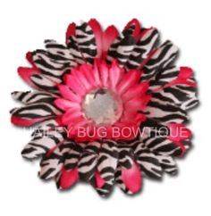 d60d1b374679  3 Hot pink and zebra layered flower clip. You can get this flower in any  color you choose! Hailey bug Bowtique · Flower hair clips