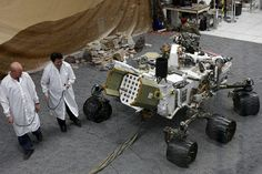 Engineers work on a model of the Mars rover Curiosity at the Spacecraft Assembly Facility at NASA's Jet Propulsion Laboratory in Pasadena, Calif.    AP Photo/Damian Dovarganes