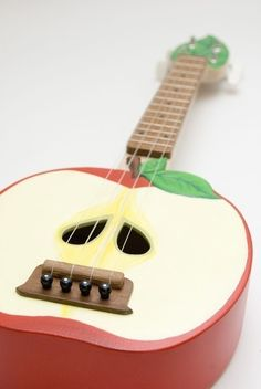 Apple Ukulele! Saw a watermelon one, but this is way cute. Wonder how it sounds tho...