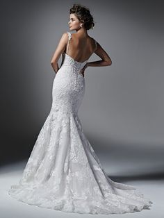 Sottero and Midgley - NATALIA, Bold lace appliqués adorn the bodice of this tulle fit and flare wedding dress with romantic sweetheart neckline. Available with corset or zipper closure with covered buttons. Detachable shoulder straps and veil sold separately.