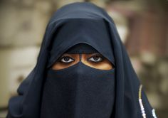 Veiled lady in Salalah, Oman by Eric Lafforgue, via Flickr