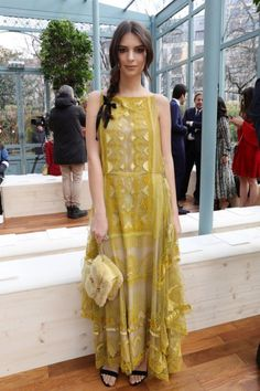 <p>Emily was a sunny delight in a yellow lacy Valentino dress.<br /><i>[Photo: Getty]</i> </p>