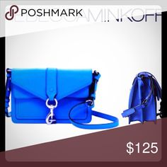 🏍Moto Mini crossbody 🏍 This is such an adorable bag!! It is the bright royal color. It features a long cross body strap and two separate areas inside to keep everything organized. It would make an excellent Gift for yourself or someone you really like! Bundle to save more! 🎉Host pick on 11/23 for best in bags!!🎉Price firm. Rebecca Minkoff Bags Crossbody Bags