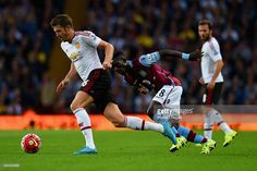 Michael Carrick of Manchester United breaks clear of Idrissa Gueye of Aston Villa during the match