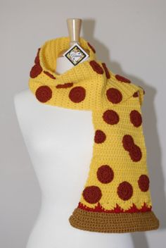 """This crocheted pepperoni scarf is handmade with 100% acrylic yarn, this yummy scarf will keep you warm in chilly weather... and will love you looking adorable too! Extra!!! Measure approximately 67 1/2"""" inches long by 6"""" inches wide. Crust - 11""""inches wide. Hand wash, dry flat."""
