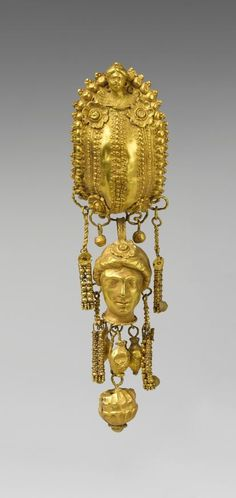 Earring with pendants and female head. Period: Hellenistic. Date: 3rd century B.C. Culture: Etruscan. Medium: Gold, silver. | © 2000–2015 The Metropolitan Museum of Art.