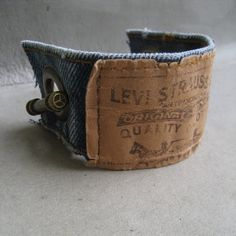 Don't throw away that old pair of Levi yet when you can make a cool Levi Denim Cuff Bracelet.