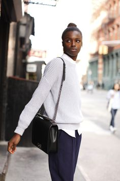 preppy. classic, casual, yet sophisticated, pretty. Dove gray sweater with white shirt and black pants and bag. Can wear other colored sweaters also - camel, dark gray, blue, etc...