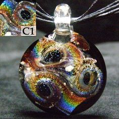 hand blown cremation glass jewelry urn by crisantiglass on Etsy, $35.00