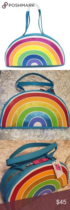 """🌈Betsey Johnson teal insulated rainbow cooler bag NWT super cute Betsey Johnson teal rainbow insulated cooler bag. This bag has an insulated lining to keep food and beverages hot or cold. Perfect for the beach or a picnic! It will also hold a lot of items,because it is large and measures 16.5"""" long and 8.5"""" high. The rainbow design is glittery,and the main color of the bag is teal. I ship same day or next day,and I accept all reasonable offers! Betsey Johnson Bags"""