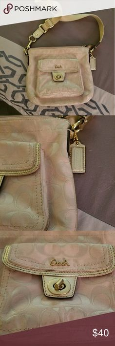 Coach pink and gold crossbody Authentic coach crossbody bag. Tan, gold and light pink make this bag go with anything! Some wear inside. Adjustable strap Zipper closure with additional clasp pocket on front. Feel free to question! Bundle and save 20% every day! 😊 Coach Bags