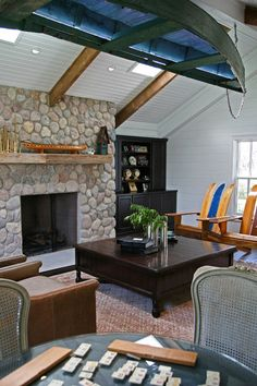 Nothing says vacation cabin like a canoe hanging in your living room and Adirondaks made from old, wooden water skis.