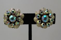 Mint Condition Gold Tone Floral Clip Earrings with Aurora Borealis Rhinestones 1950-60s by thejeweledbear on Etsy