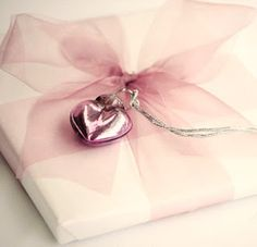 Pretty pink packages tied up with string, these are a few of my favorite things! #LillyHoliday