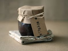 Use a small circle of kraft paper to decorate homemade jars of jams or other preserves. Secure with a piece of twine and tag.