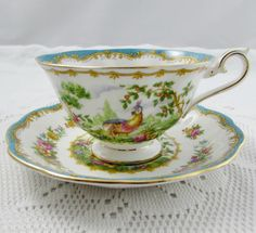 "Royal Albert ""Chelsea Bird"" Blue Tea Cup and Saucer with Colorful Flowers and Bird, Vintage Bone China"