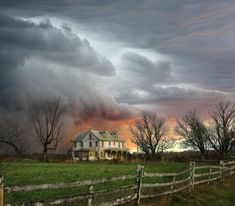 Storm clouds approach an abandoned farmhouse north of Vincentown, New Jersey.