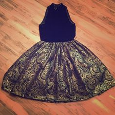 NWT Saks Fifth Avenue Morton Myles Vintage Dress Gorgeous vintage Morton Myles dress never been worn with tags attached from Saks Fifth Avenue. Amazing velvet top with high neck line. Amazing gold puffy bottom beautiful stitch detailing. Size 6 brand new! Saks Fifth Avenue Dresses Midi