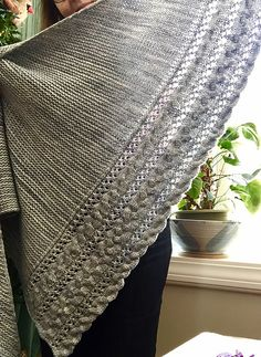 Fallen Cloud by Lisa Hannes- Looks like it's knit in one piece from one point of the lace and cable edge and gradually adding garter stitch