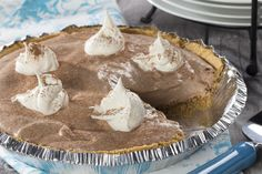 """Our light version of Creamy Chocolate Pie is good as is, or you may want to toss on some fresh raspberries, or a dollop of low-fat whipped topping with a few sprinkles to give it a """"wow"""" finishing touch."""