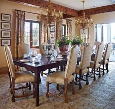 Antique French chairs and custom hand-carved Italian chandeliers give this dining room Old World elegance - Traditional Home® / Photo: Werner Straube / Design: Todd Richesin