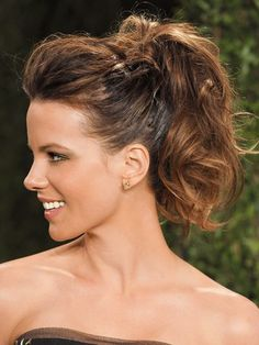 "Kate Beckinsale When we say ""high and fluffy,"" think flirty volume, not Pomeranian. Create a bit of feminine bounce by first wrapping large sections of hair around a one-inch curling iron. If the idea of that much heat styling is already making you sweat, you can curl just the ends after securing your ponytail. Tease the crown, then pull hair up and tightly fasten at the top of the head. Make it even fuller by opening up the ponytail with your fingers and teasing the base lightly."
