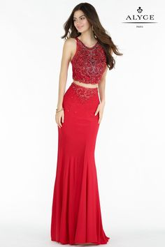 Alyce Paris 6709 is a jersey two piece gown with a fully embellished scoop neckline crop top and a strappy back.