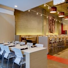 Warming elements were added to the existing industrial interior at Slurping Turtle (Chicago).