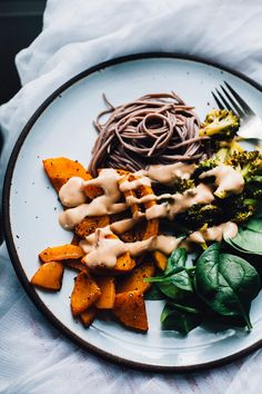 A savory, easy vegan dinner! Buckwheat Soba with Bangarang Tahini Sauce, plus tamari broccoli and allspice roasted butternut squash! Get the recipe.