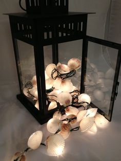 These would be so cute for Christmas or around a tiki bar, Scallop Shell Christmas Lights by McGrathAdams on Etsy, $52.00