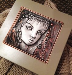 """pewter and copper high relief face created by Mary Ann Lingenfelder (design from the new Impressions in metal, book 2) and placed on a keepsake box in the new """"stone"""" colour from Mimmic Gallery and Studio. Available online from www.mimmic.co.za"""