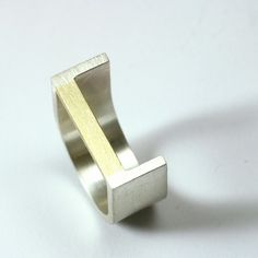 silver and yellow gold ring