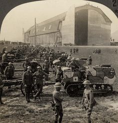 American soldiers of the 89th Infantry Division posing with their tractor-drawn artillery in front of what was said to be the largest Zeppelin hangar in Germany at Trier Air Base during the Occupation of the Rhineland, 1918. Animated stereoview. More information. Wikipedia entry. Original stereocard.
