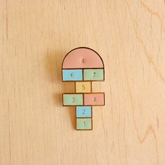 Hopscotch pin - such a sweet childhood memory! ❤️ Wonder if kids today even know what hopscotch is. Shrinky Dinks, Hopscotch, Cool Pins, Bijoux Diy, Pin And Patches, Up Girl, Pin Badges, Lapel Pins, Pin Collection