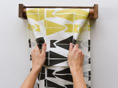 The goldenrod and grey abstract kite pattern make this linen roller towel a point of interest in your kitchen or bathroom. Easy to remove from the wooden holder. Washable and absorbent. Find details and more designs at keephousestudio